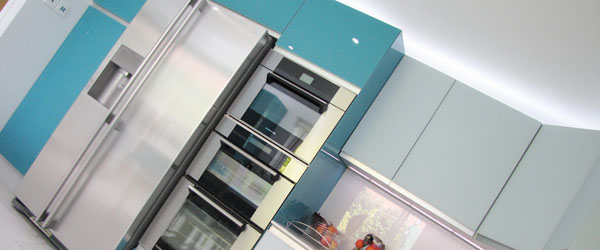 Gloss Teal & Satin Powder Blue Glass kitchen designed and installed by ASL Kitchens & Bathrooms